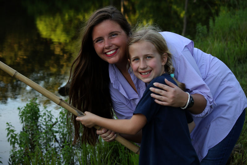 Danni & Paige broke in our new cane poles while fishing at the iPond.