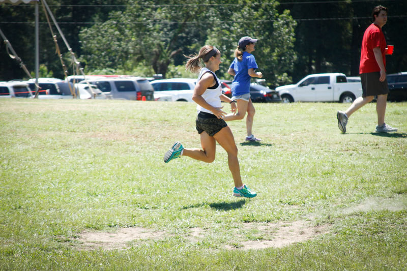 Dana Stilley sprints across the front yard in the Iron Man relay.