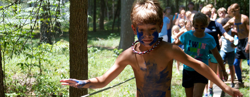 Obstacle Course - race through the Pineywoods and beat your personal best OC time! Zachary (1st yr, 2nd gen camper) leads the Tejas across the foot bridge.