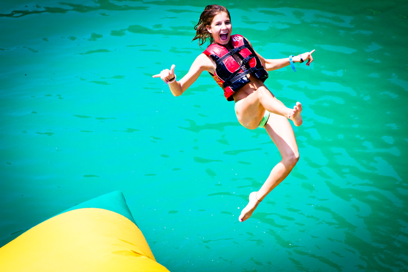Taighen (10 yrs at camp) soars high from a critter/blob bounce!