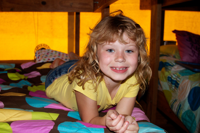 Taylor (1st yr at camp, 2nd generation camper) smiles big in Willow Glen, where 7yr old girls get to spend their first summer!