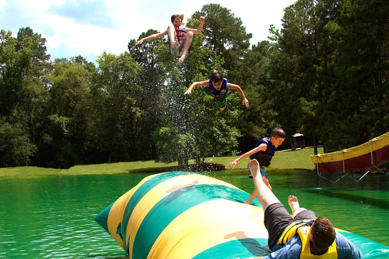 Brett (4 yrs at camp) sends his buddies Evan (3 yrs at camp), Dayton (2 yrs at camp) and Brady (1st yr) airborne on the Critter (blob)!!